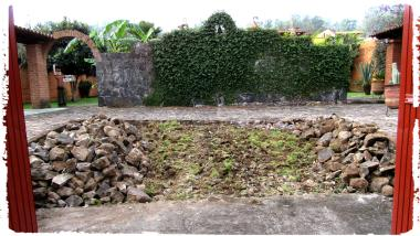 Stones removed and piled on sides.